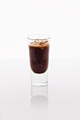 A shot of iced espresso