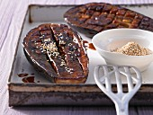 Grilled aubergines with miso sauce and sesame seeds