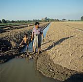 Thai farmer and son