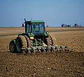 Harrowing Field to prepare Seedbed
