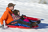 Sledding on a Snowy Hill