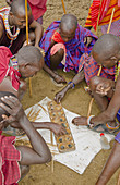 Masai Men Playing Bao Game in Village