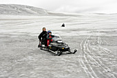 Snowmobiling on a glacier,Iceland