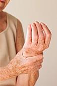 Elderly woman with wrist pain