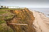 Eroded coast revealing drainage pipes