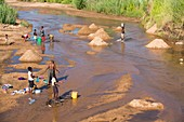 Workers extracting river sands