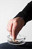 Person extinguishing cigarette