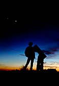Amateur astronomer looks at planetary conjunction