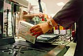 Bar code reader at supermarket checkout