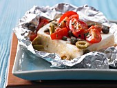 Sheep's cheese with tomatoes and olives in foil