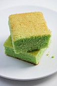 Two slices of Singaporean pandan chiffon cake