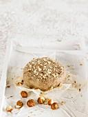 Vegan cashew cheese with chopped hazelnuts