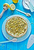 Lemon and caramel tart topped with pistachio nuts