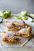 Freshly baked apple turnovers on a cooling tray