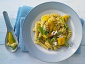 Curry and mango pasta with cashew nuts and coriander