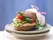 A turkey sandwich with avocado cream, watercress and tomato