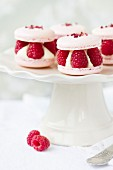 Macarons filled with fresh raspberries and cream