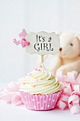Cupcake with it s a girl pick