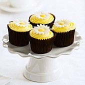 Yellow cupcakes on a white cakestand