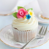 Cupcake decorated with sugar flowers