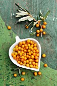 Sea buckthorn berries in a heart-shaped dish
