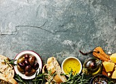 Italian food ingredients background with Sliced bread Ciabatta, parmesan, olive oil, olives and rosemary