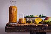 Turmeric Orange Poppy Seed Dressing in a bottle and a glass