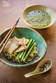 Japanese tsukemen ramen soup with a cold cucumber dip and pork