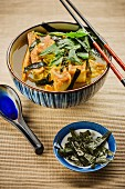 Japanese ramen soup with spicy tofu and seaweed