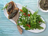 Rocket salad with olive crostini and pepper vinaigrette