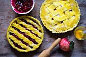 Rustic cherry and apple lattice pies before baking