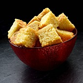 Cornbread cut into cubes in a bowl