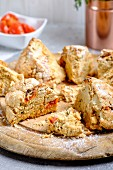 Irish tomato and thyme soda bread cut into chunks on a wooden board
