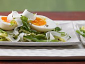 Medium-soft (waxy) boiled eggs on a bed of savoy cabbage and beans