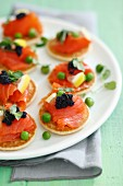 Blinis with smoked salmon, caviar and green peas