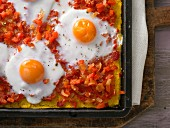 Mexican-style polenta pizza with red pepper salsa and egg