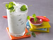 A yoghurt smoothie with lime juice, herbs and cardamon