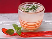 A sparkling apple and ginger drink with mint