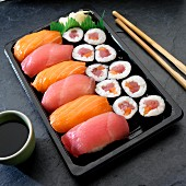 Nigiri and Maki sushi with salmon and tuna (Japan)