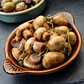 Marinated mushrooms with thyme as tapas in a dish (Spain)