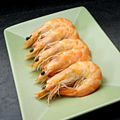Five boiled prawns on a serving dish