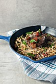 Spaghetti with beef, tomatoes and basil