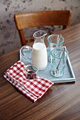 Ingredients for hot chocolate: milk, hot chocolate and glasses