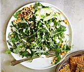 Kale and rocket salad with avocado and walnuts