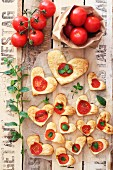 Heart-shaped puff pastries with tomato and basil