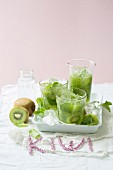 Mojitos with kiwi, cucumber and apple