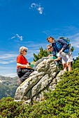 Women looking at their maps whilst hiking in Valais, Switzerland