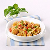 Farfalle alla Crudaiola with mozzarella balls in breadcrumbs