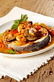 Swordfish with prawns and mushroom sauce