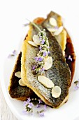 Trout in sauce with almonds and lavender